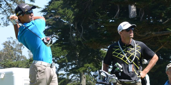Andy Zhang, 14, hits his tee ball at the par-4 6th hole as caddie Christopher Gold looks on at Olympic Club in San Francisco.