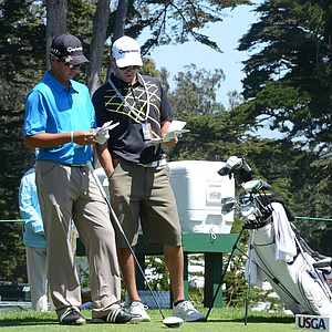 Andy Zhang, left, and caddie Christopher Gold go over yardages on the tee at the par-4 6th hole at Olympic Club in San Francisco.