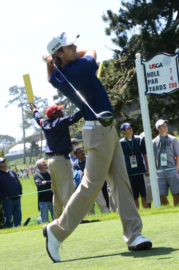 Aaron Baddeley, playing with Andy Zhang, 14, hits his tee shot at the par-4 7th hole during his practice round on Tuesday at the Olympic Club.