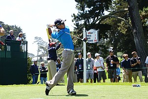 Andy Zhang, 14, hits his tee shot at the par-4 7th hole during his practice round on Tuesday at the Olympic Club.