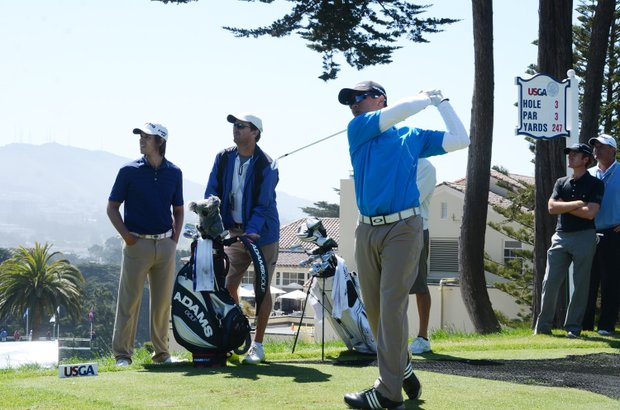 Andy Zhang, right, tees off at the par-3 3rd hole, as Aaron Baddeley, left, looks on at Olympic Club in San Francisco.