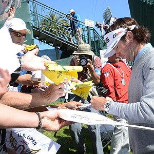 Bubba Watson signs autographs after completing his 10th and final hole at the par-4 18th during a practice round at Olympic Club in San Francisco.
