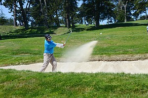 Andy Zhang, 14, hits out of a bunker at the par-4 4th hole during a practice round at Olympic Club in San Francisco.