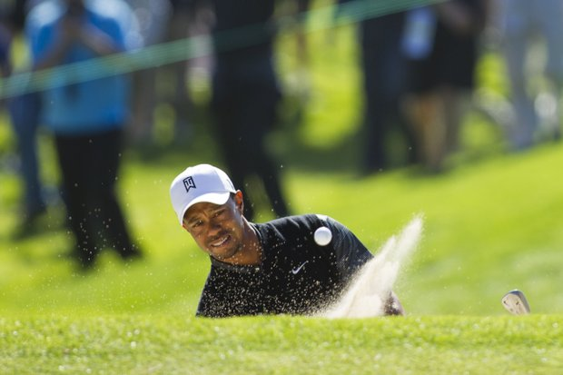 Tiger Woods plays out of the bunker on the 17th hole during a practice round at the 2012 U.S. Open at The Olympic Club in San Francisco, Calif. on Monday, June 11, 2012.