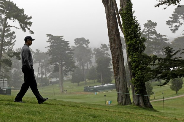 Tiger Woods makes his way down the ninth hole during a practice round for the U.S. Open Championship golf tournament Wednesday, June 13, 2012, at The Olympic Club in San Francisco.