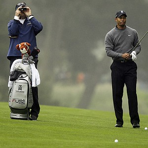 Tiger Woods gets ready to hit on the 14th hole during a practice round for the U.S. Open Championship golf tournament Wednesday, June 13, 2012, at The Olympic Club in San Francisco.
