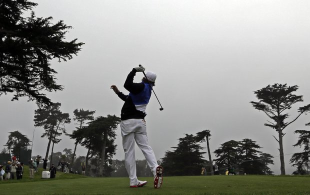 Rickie Fowler hits a drive on the fourth holeduring a practice round for the U.S. Open Championship golf tournament Wednesday, June 13, 2012, at The Olympic Club in San Francisco.