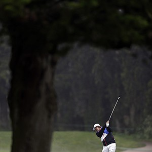 Rickie Fowler hits a shot on the fifth hole during a practice round for the U.S. Open Championship golf tournament Wednesday, June 13, 2012, at The Olympic Club in San Francisco.