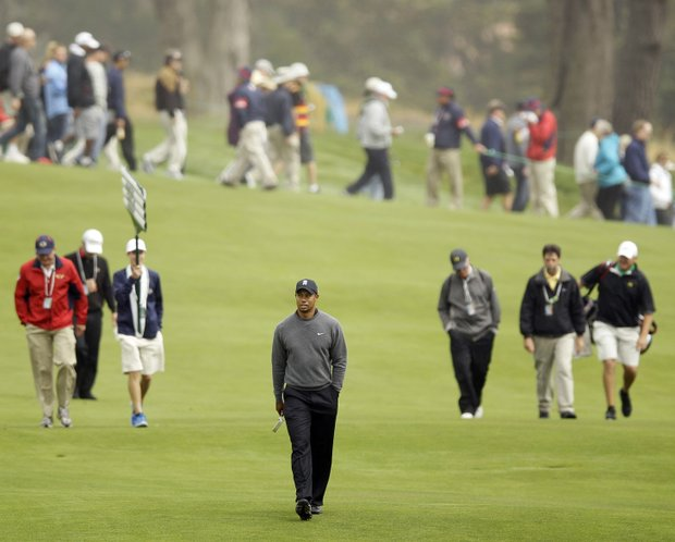 Tiger Woods walks up the second fairway during a practice round for the U.S. Open Championship golf tournament Wednesday, June 13, 2012, at The Olympic Club in San Francisco.