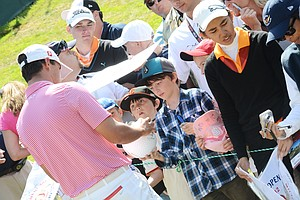 Brooks Koepka signs autographs behind the 8th green during a practice round on Wednesday at the Olympic Club in San Francisco.