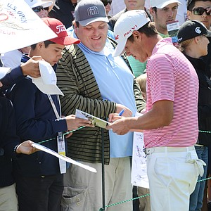 Brooks Koepka signs autographs behind the 8th green at the conclusion of his Wednesday practice round at Olympic Club in San Francisco.