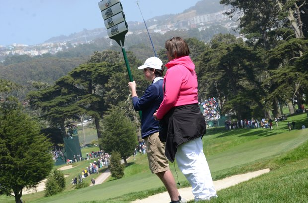 Denise Jakows stands greenside at the par-4 7th hole as her son, Brooks Koepka, putts during a practice round on Wednesday at Olympic Club in San Francisco.