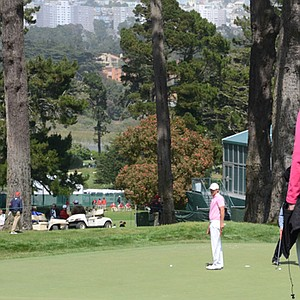 Back inside the ropes, Denise Jakows (in pink) watches her son, Brooks Koepka, putt on the 7th green during a practice round on Wednesday at Olympic Club in San Francisco.