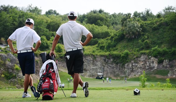 Brooks Koepka, right, and younger brother Chase wait on the 17th tee during the final round at the U.S. Open sectional qualifier at Black Diamond Ranch in Lecanto, Fla.