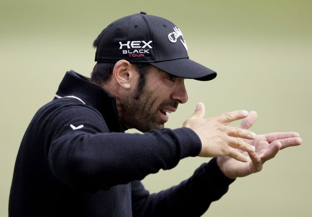 Alvaro Quiros, of Spain, gestures during a practice round for the U.S. Open Championship golf tournament Wednesday, June 13, 2012, at The Olympic Club in San Francisco.