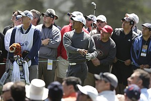 Tiger Woods hits a drive on the fourth hole during the first round of the U.S. Open Championship golf tournament Thursday, June 14, 2012, at The Olympic Club in San Francisco.