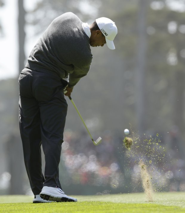 Tiger Woods hits a shot on the fifth hole during the first round of the U.S. Open Championship golf tournament Thursday, June 14, 2012, at The Olympic Club in San Francisco.