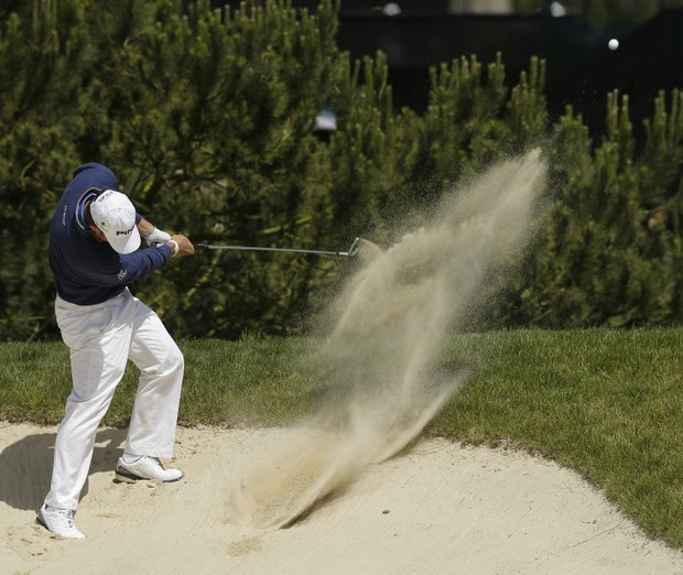 Lee Westwood, of England, hits out of a bunker on the sixth hole during the first round of the U.S. Open Championship golf tournament Thursday, June 14, 2012, at The Olympic Club in San Francisco.