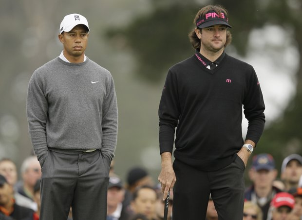 Bubba Watson and Tiger Woods wait to putt on the 10th green during the first round of the U.S. Open Championship golf tournament Thursday, June 14, 2012, at The Olympic Club in San Francisco.