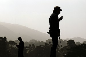 Phil Mickelson and Bubba Watson, left, on the 17th green during the first round of the U.S. Open Championship golf tournament Thursday, June 14, 2012, at The Olympic Club in San Francisco.
