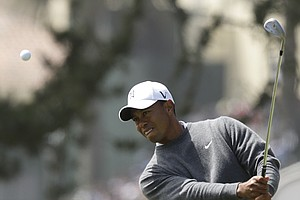 Tiger Woods chips to the third green during the first round of the U.S. Open Championship golf tournament Thursday, June 14, 2012, at The Olympic Club in San Francisco.