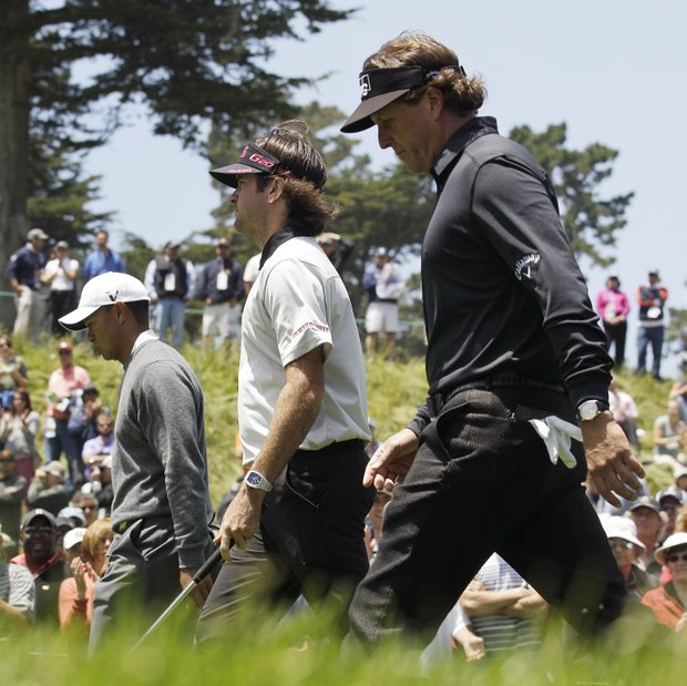 Tiger Woods, left to right, Bubba Watson and Phil Mickelson walk up the 18th hole during the first round of the U.S. Open Championship golf tournament Thursday, June 14, 2012, at The Olympic Club in San Francisco.