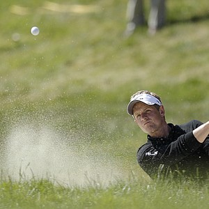 Luke Donald, of England, hits out of a bunker on the 17th hole during the second round of the U.S. Open Championship golf tournament Friday, June 15, 2012, at The Olympic Club in San Francisco.