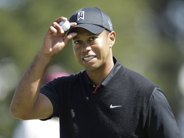 Tiger Woods reacts after making a birdie on the 10th hole during the second round of the U.S. Open Championship golf tournament Friday, June 15, 2012, at The Olympic Club in San Francisco.