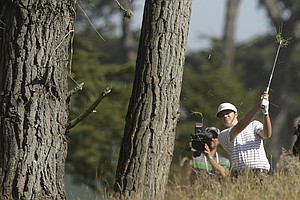 Amateur Beau Hossler hits out of the rough on the fourth hole during the second round of the U.S. Open Championship golf tournament Friday, June 15, 2012, at The Olympic Club in San Francisco.