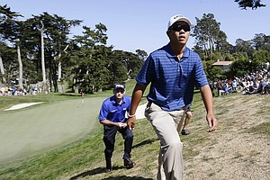 Andy Zhang walks off the 18th green during the second round of the U.S. Open Championship golf tournament Friday, June 15, 2012, at The Olympic Club in San Francisco.