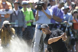 Tiger Woods hits out of a bunker on the fifth hole during the second round of the U.S. Open Championship golf tournament Friday, June 15, 2012, at The Olympic Club in San Francisco.
