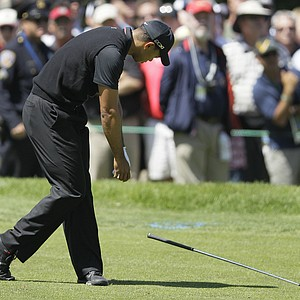 Tiger Woods drops his club after a shot on the sixth hole during the second round of the U.S. Open Championship golf tournament Friday, June 15, 2012, at The Olympic Club in San Francisco.