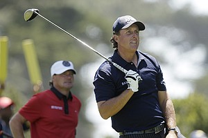 Phil Mickelson watches his shot on the seventh hole during the third round of the U.S. Open Championship golf tournament Saturday, June 16, 2012, at The Olympic Club in San Francisco.