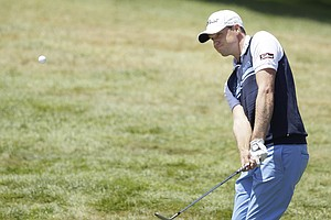 Nick Watney hits a shot on the second hole during the third round of the U.S. Open Championship golf tournament Saturday, June 16, 2012, at The Olympic Club in San Francisco.