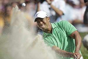 Tiger Woods hits out of a bunker on the 7th hole during the third round of the U.S. Open Championship golf tournament Saturday, June 16, 2012, at The Olympic Club in San Francisco.
