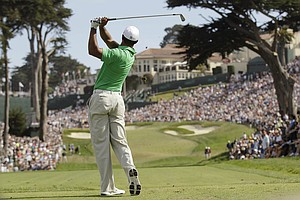 Tiger Woods hits a shot on the eighth hole during the third round of the U.S. Open Championship golf tournament Saturday, June 16, 2012, at The Olympic Club in San Francisco.
