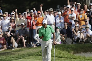 Tiger Woods reacts as be makes a birdie putt on the ninth hole during the third round of the U.S. Open Championship golf tournament Saturday, June 16, 2012, at The Olympic Club in San Francisco.