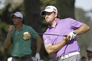 Graeme McDowell, of Northern Ireland, watches his drive on the 11th hole during the third round of the U.S. Open Championship golf tournament Saturday, June 16, 2012, at The Olympic Club in San Francisco.