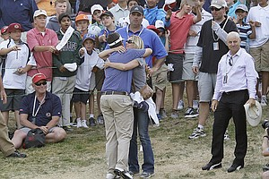 Amateur Beau Hossler hugs his mother Amy Balsz after the third round of the U.S. Open Championship golf tournament Saturday, June 16, 2012, at The Olympic Club in San Francisco.