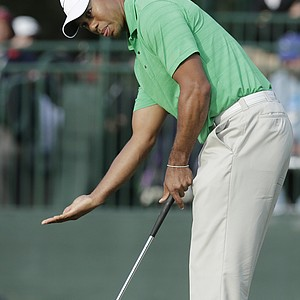 Tiger Woods reacts after missing a par putt on the 16th hole during the third round of the U.S. Open Championship golf tournament Saturday, June 16, 2012, at The Olympic Club in San Francisco.