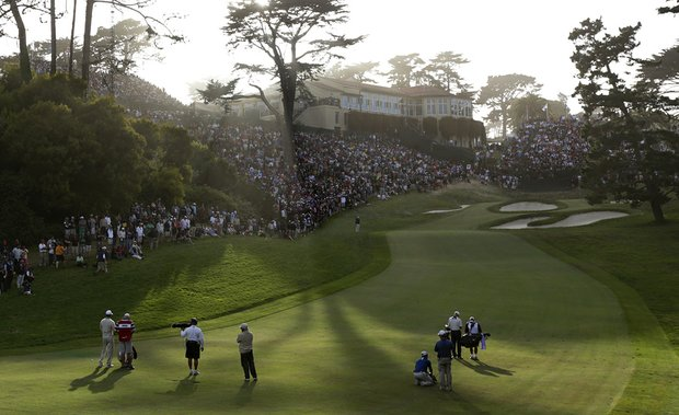 Tiger Woods and Jim Furyk make their way up the 18th hole on Saturday at Olympic Club.