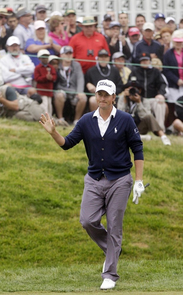 Webb Simpson waves after chipping on the 18th hole during the fourth round of the U.S. Open Championship.