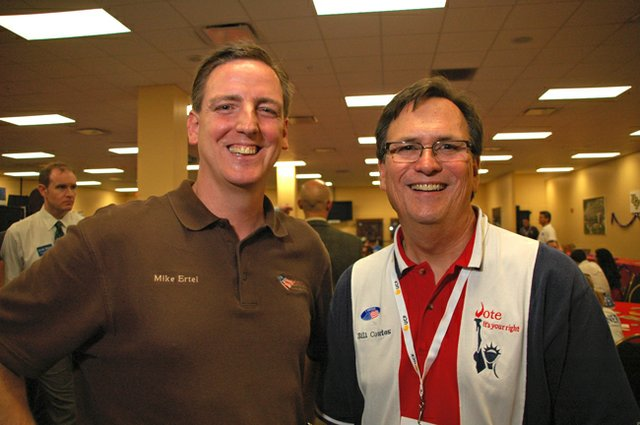 Seminole County Supervisor of Elections Mike Ertel and Orange County Supervisor of Elections Bill Cowles pose at the East Side Regional Hob Nob June 26.