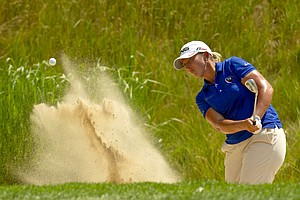 Angela Stanford plays out of the greenside bunker on the 11th hole during the first round at the 2012 U.S. Women's Open at Blackwolf Run in Kohler, Wis. on Thursday, July 5, 2012.