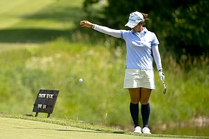 Ai Miyazato takes a drop on the 16th hole during the first round at the 2012 U.S. Women's Open at Blackwolf Run in Kohler, Wis. on Thursday, July 5, 2012.