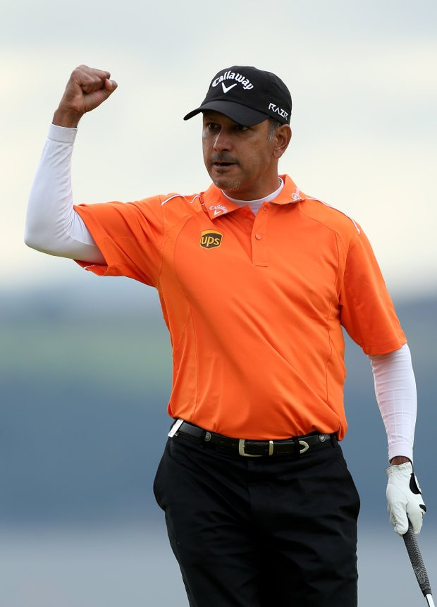 Jeev Milkha Singh celebrates holing a putt during a playoff against Francesco Molinari to win on the 18th green during the final round of the Scottish Open at Castle Stuart Golf Links.