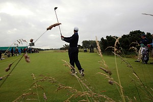 Tiger Woods plays the ninth hole during a practice round in preparation for the 2012 Open Championship at Royal Lytham and St. Annes.