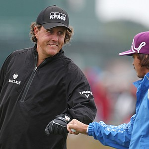 Phil Mickelson, left, and Rickie Fowler celebrate a shot during the second practice round prior to the start of the 141st Open Championship at Royal Lytham & St. Annes.