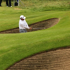 Graeme McDowell plays out of a bunker on the ninth hole at Royal Lytham and St. Annes in Lytham ahead of the 2012 Open Championship.