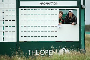 Scoreboard staff watch the action during the third practice round prior to the start of the 141st Open Championship at Royal Lytham & St. Annes.